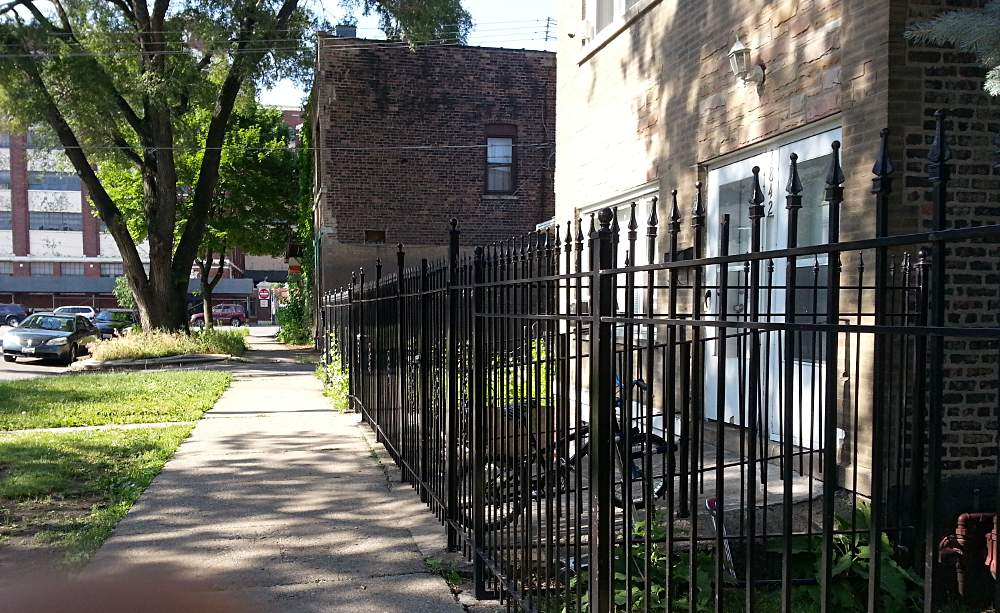 The new fence at 3842 S. Honore is part of the owner's active efforts to keep gang members away from the property.