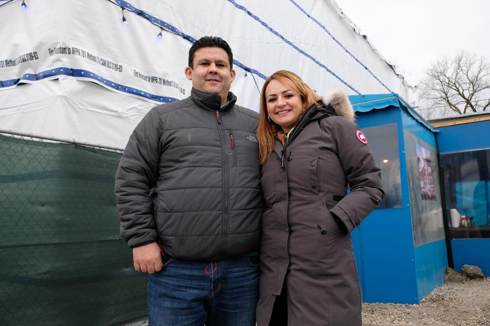 Owners Alejandro and Diana Guerra stand in front of new construction at their restaurant, La Palapa, at 2000 W. 34th Street.