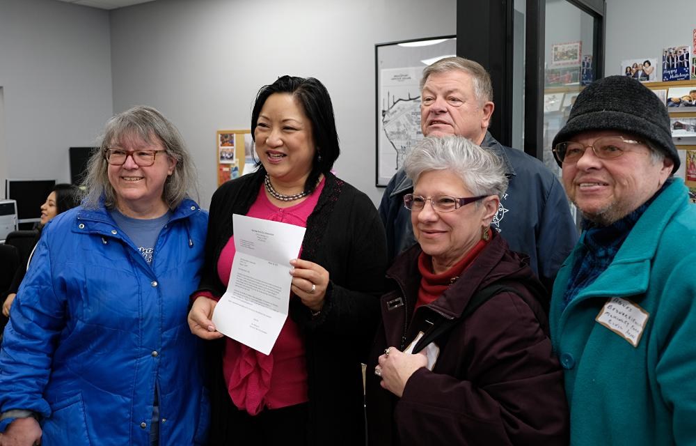 Rep. Theresa Mah gets notice of her award from civic association leaders, including Sue and Roy Pletsch, Darlene Bania, and Agnes Bednarkiewicz, at the open house on Saturday, January 20.