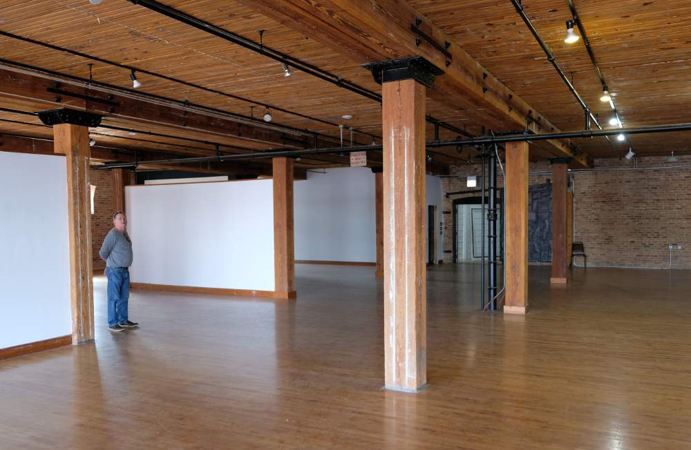 36Squared Executive Director Andrew Fogaty reviews some of the available space at the incubator.