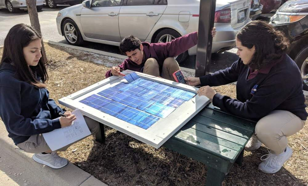 Horizon Science Academy students test one of the photovoltaic panels as part of the Green Power for Green Spaces project.