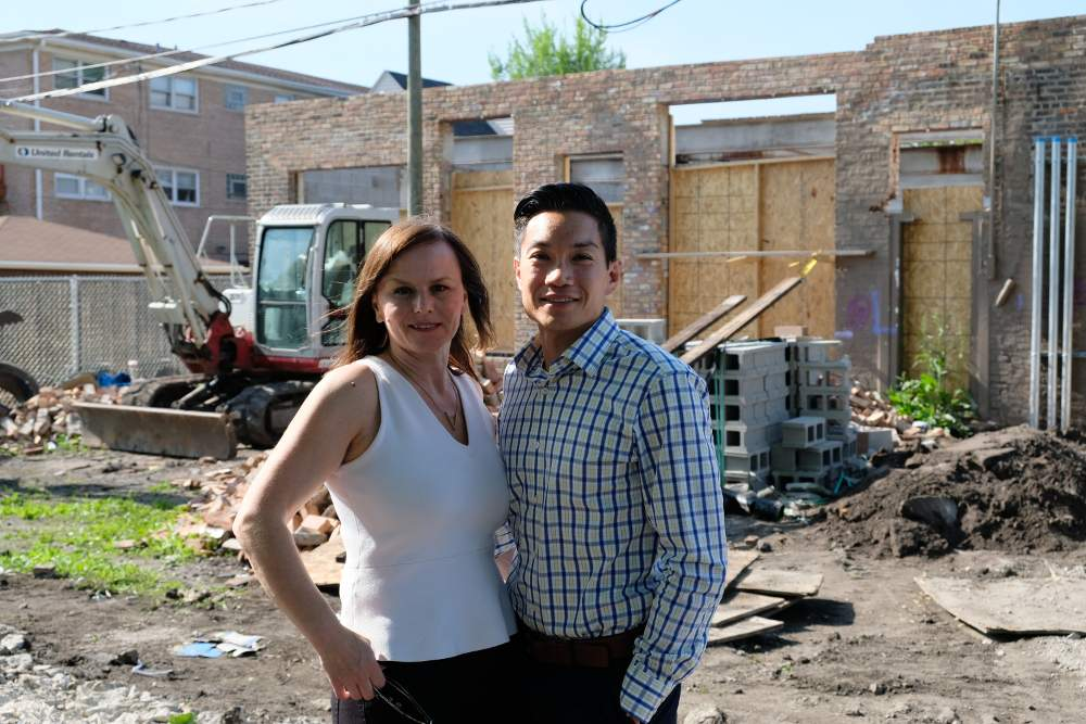 Principal Beata Skorusa stands with husband and business partner Mark Javier in front of active construction at their new school site, set to open in fall 2018.