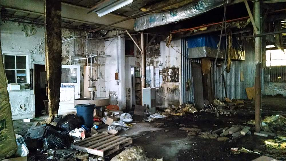 Extensive dilapidation from long abandonment extends throughout the building as shown in this photo taken shortly after purchase.