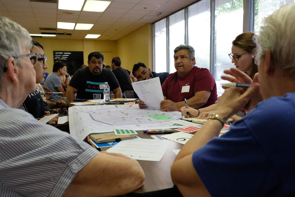Development workshop participants discuss neighborhood assets and concerns during the July 18  launch of the McKinley Park neighborhood plan project.