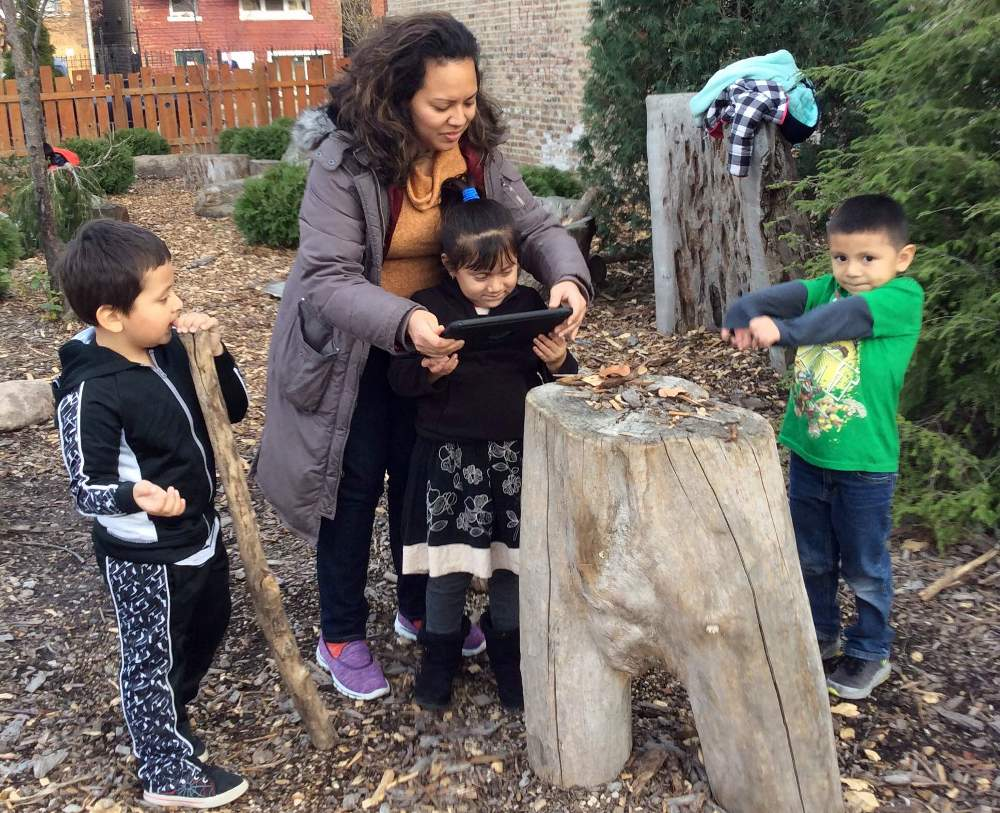 Jessica Fong engages with students in 2017 at the Jardincito play garden, which informed her research project on nature-based play.
