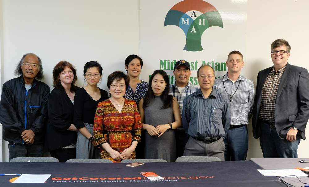 McKinley Park Underage Drinking and Other Substance Abuse Prevention Coalition members gather after their September 13 meeting at the Midwest Asian Health Association.