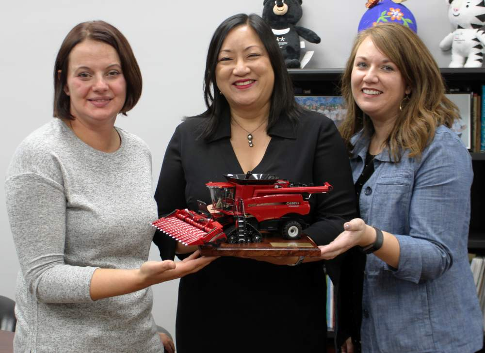 Illinois 2nd District State Representative Theresa Mah, center, accepts her Friend of Agriculture award from Bona Heinsohn, Director of Governmental Affairs and Public Relations at Cook County Farm Bureau, and McDonough County Farm Bureau Manager Sarah Grant on October 5 in a ceremony at the 2nd District office.