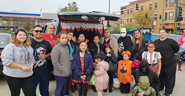 Students, parents and staff pose at one of the stops at Nathanael Greene Elementary School's Trunk or Treat event on Tuesday, October 30.