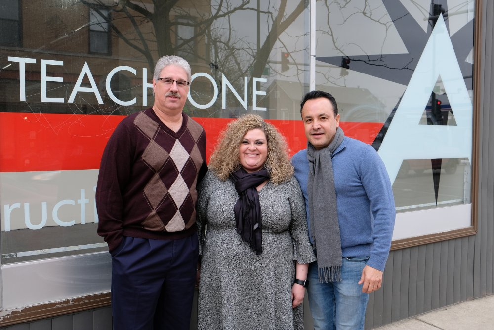 Topnotch Silkscreen owner Anthony Slezak, Aquinas Literacy Center Executive Director Alison Altmeyer and 12th Ward Alderman George Cardenas gather in front of Aquinas' storefront facade, which is slated for an overhaul with its Small Business Improvement Fund grant.