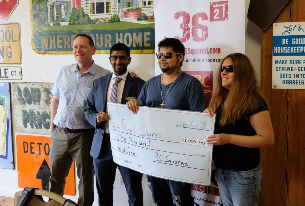 Roel Cano, second from right, accepts his 2018 Boost Award from committee members Andrew Fogaty, Hussein Bhanpuri and Laura Martinez.