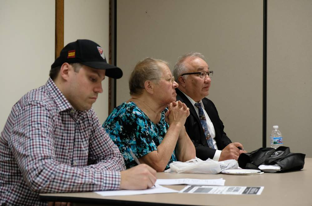 Local attorney Steve Demitro, right, answers questions about tenants rights alongside McKinley Park Civic Association officers Chris Bania and Anges Bednarkiewicz at the June 5 association meeting.