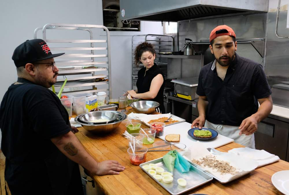 Xavier Hernandez, Irene Acosta and Miguel Hernandez prep test dishes in the Pochos kitchen prior to their brunch opening on Saturday, August 24.