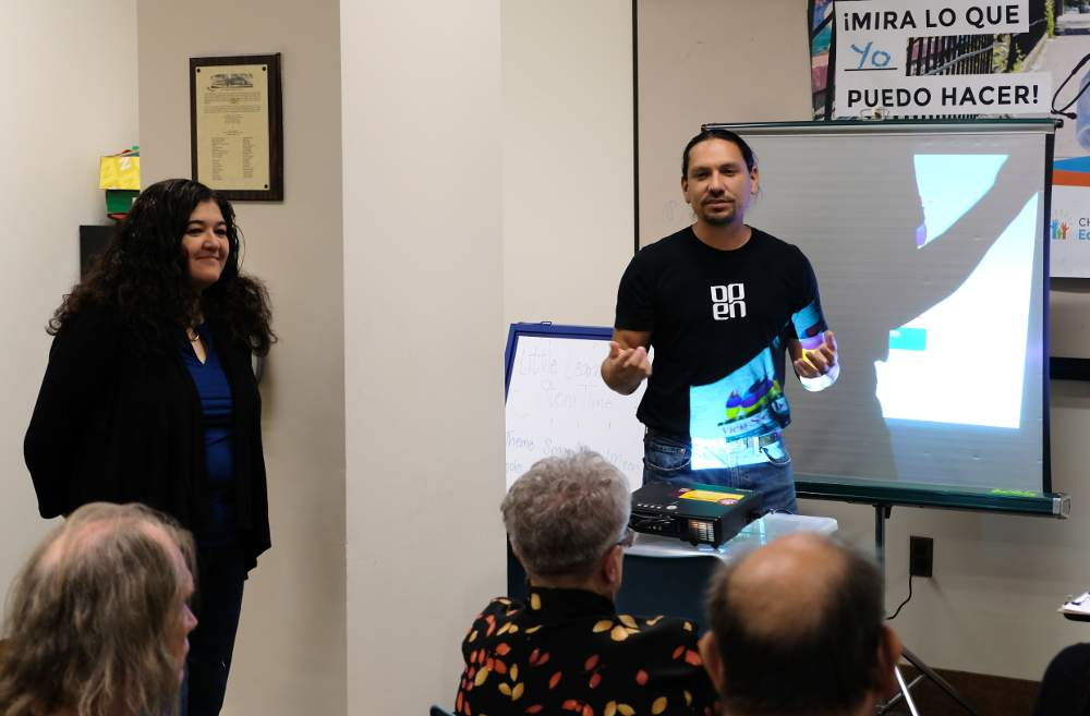 Open Center for the Arts Executive Director Omar Magaña presents their plan for a mural on Damen Avenue alongside Gabriela Juarez at the Wednesday, September 4, meeting of the McKinley Park Civic Association.
