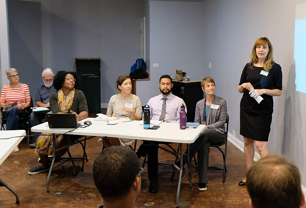 McKinley Park Development Council board member Kara Breems, right, introduces panelists during the September 18 meeting at Kristoffer's Cakes.