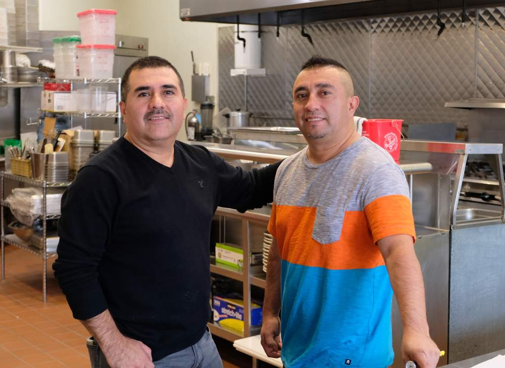 Brothers Jaime Sotelo, left, and Alfonso Sotelo stand ready in the kitchen of their soon-to-open restaurant Chile Toreado at 2022 W. 35th St., Chicago.