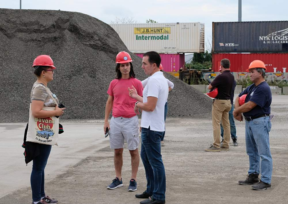 MAT Asphalt co-owner Michael Tadin Jr., center, discusses plant operations with members of Neighbors for Environmental Justice during the tour on Saturday, September 21.