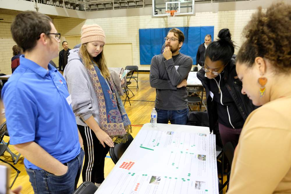 Council President John Belcik, center, discusses the neighborhood plan at the McKinley Park Development Council meeting on Wednesday, October 16, at the McKinley Park field house.