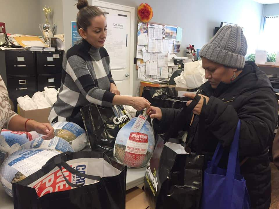 12th Ward staff give away turkeys and bags of holiday food at the Thanksgiving Turkey Raffle on Friday, November 22, at the 12th Ward office at 3476 S. Archer Ave., Chicago.