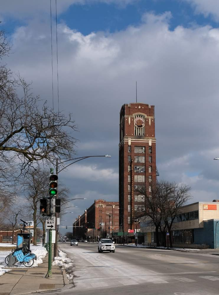The iconic clock tower and monolithic buildings of the Central Manufacturing district march east and west from where South Damen Avenue ends at West Pershing Road.