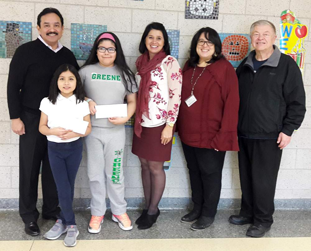 Illinois 1st District State Senator Tony Muñoz, left, stands alongside winning Nathanael Greene Elementary School writers L. Cruz and Z. Martinez, joined by Principal Shelley Lugo-Cordova, center, Assistant Principal Myrna Villafuerte and Roy Pletsch of the McKinley Park Civic Association.