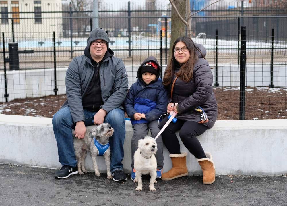 Daniel Lopez, left, Leo Lopez and Diana Chacon enjoy the new dog-friendly area in McKinley Park along with their two dogs.