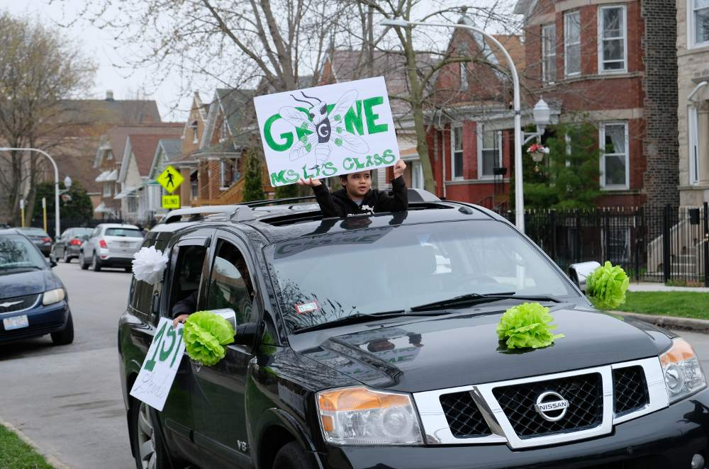 Nathanael Greene Elementary first grader Michael Gonzalez is ready to cheer his teachers and school during the drive-through parade on Friday, April 24.