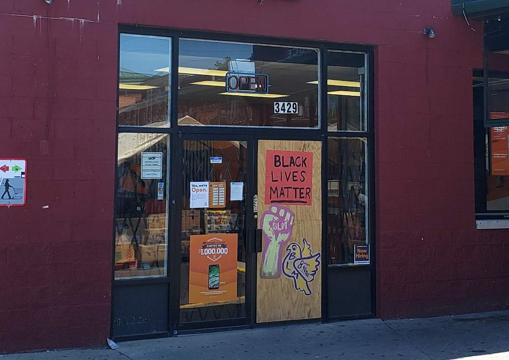 The McKinley Park neighborhood Boost Mobile store at 3429 S. Archer Ave., Chicago, shares Black Lives Matter messaging on its storefront.