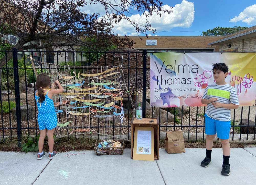 Velma Thomas Early Childhood Center students weave a word wall of memories of their school experience on Thursday, June 11, in front of the school at 3625 S. Hoyne Ave., Chicago.