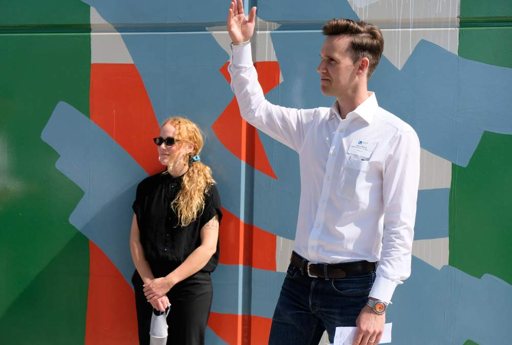 Logistics Property Co. Executive Vice President Aaron Martell introduces artist Ellen Rutt and her new mural artwork at its dedication on September 25, 2020, at 3711 S. Ashland Ave., Chicago.