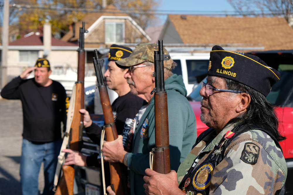 Honor guard members for American Legion William McKinley Post 231 commemorate the service of armed forces members at the post's Veterans Day ceremony on November 11, 2020.