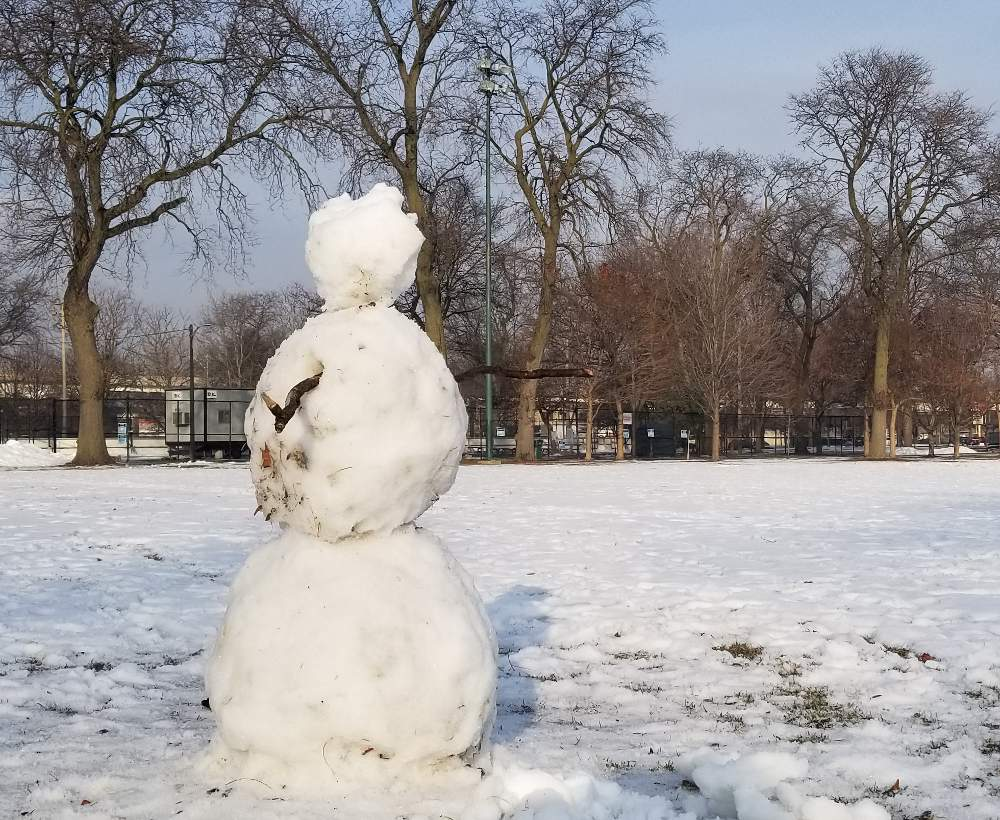 One lonely McKinley Park snowman awaits its brethren to join it for the McKinley Park Snowman Contest running through February 20, 2021.