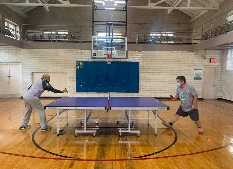 Veterans face off in a table tennis game at the McKinley Park field house as part of a new program series.