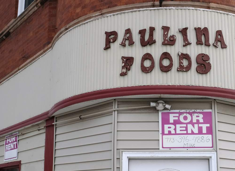 For Rent signs advertise the empty storefront of the former Paulina Foods in the McKinley Park neighborhood.
