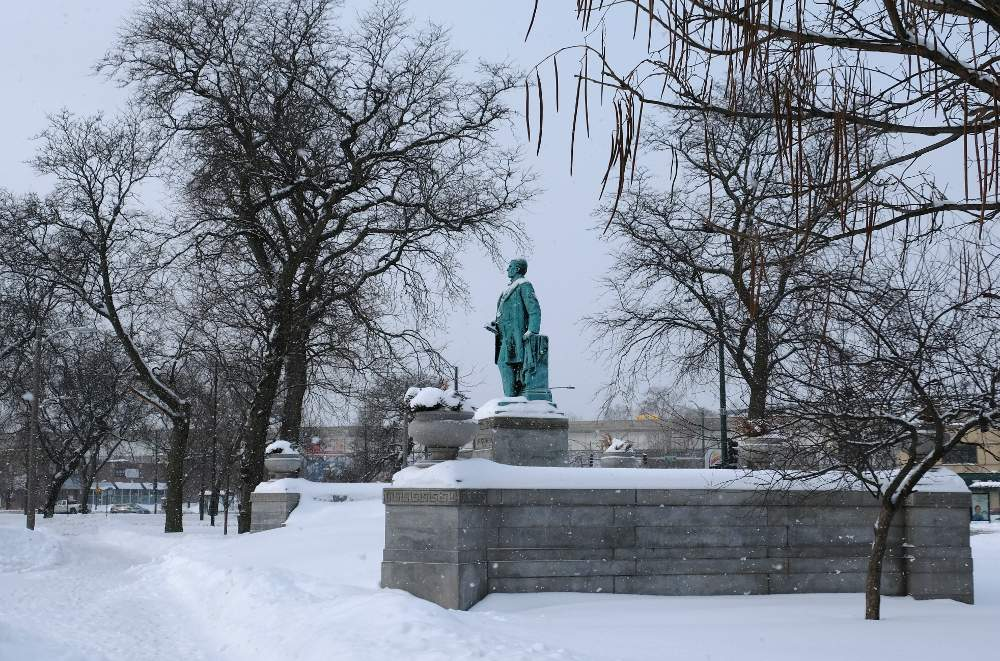 More snow falls on the President William McKinley memorial in Chicago's McKinley Park.