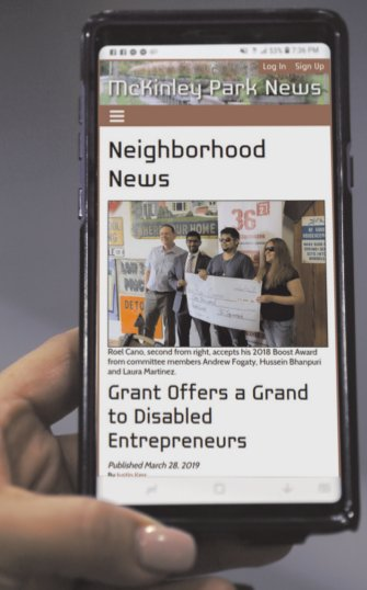 McKinley Park News mobile screen in hand